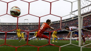 Atletico Madrid's Tiago scores a goal past Getafe's goalkeeper Guaita during their Spanish first division soccer match in Madrid
