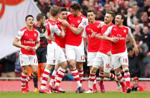 "Football - Arsenal v Liverpool - Barclays Premier League - Emirates Stadium - 4/4/15 Hector Bellerin celebrates scoring the first goal for Arsenal with team mates Action Images via Reuters / John Sibley Livepic EDITORIAL USE ONLY. No use with unauthorized audio, video, data, fixture lists, club/league logos or ""live"" services. Online in-match use limited to 45 images, no video emulation. No use in betting, games or single club/league/player publications.  Please contact your account representative for further details."
