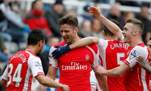 """Football - Newcastle United v Arsenal - Barclays Premier League - St James' Park - 21/3/15Arsenal's Olivier Giroud celebrates scoring their second goal with Francis Coquelin, Calum Chambers and Gabriel Paulista Reuters / Andrew YatesLivepicEDITORIAL USE ONLY. No use with unauthorized audio, video, data, fixture lists, club/league logos or """"live"""" services. Online in-match use limited to 45 images, no video emulation. No use in betting, games or single club/league/player publications.  Please contact your account representative for further details."""