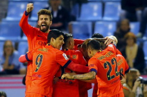 Barcelona's players celebrate their goal against Celta Vigo during their Spanish first division soccer match at the Balaidos stadium in Vigo