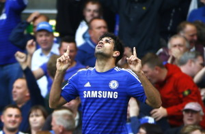 Chelsea's Costa celebrates scoring a goal against Arsenal during their English Premier League soccer match at Stamford Bridge in London