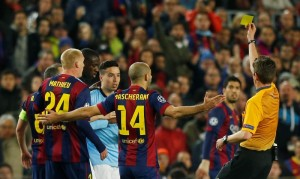 Football - FC Barcelona v Manchester City - UEFA Champions League Second Round Second Leg - The Nou Camp, Barcelona, Spain - 18/3/15Manchester City's Samir Nasri is shown a yellow card by referee Gianluca RocchiAction Images via Reuters / Carl RecineLivepicEDITORIAL USE ONLY.
