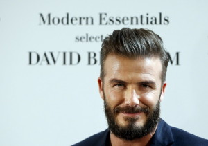 Former England soccer captain David Beckham poses for photographers at a H&M store in central Madrid