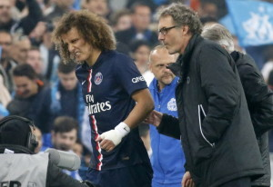 Paris St Germain's Luiz reacts after being injured during their French Ligue 1 soccer match against Olympique Marseille at the Velodrome stadium in Marseille