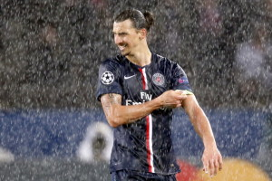 Paris St Germain's Zlatan Ibrahimovic leaves the field under heavy rain in their Champions League Group F soccer match against Ajax Amsterdam at the Parc des Princes Stadium in Paris