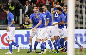 Italy's Graziano Pelle celebrates with his team mates after scoring against England during their international friendly soccer match at Juventus Stadium in Turin