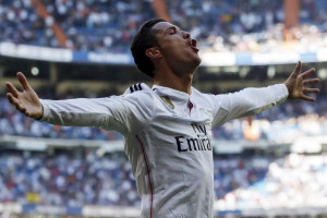 Real Madrid's Cristiano Ronaldo celebrates his fifth goal against Granada during their Spanish first division soccer match at Santiago Bernabeu stadium in Madrid