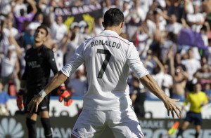 Real Madrid's Ronaldo celebrates past Levante's goalkeeper Marino after he scored a penalty during their Spanish first division soccer match in Valencia